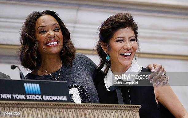 Julie Chen and Aisha Tyler of CBS' The Talk ring the closing bell at the New York Stock Exchange on December 9 2015 in New York City