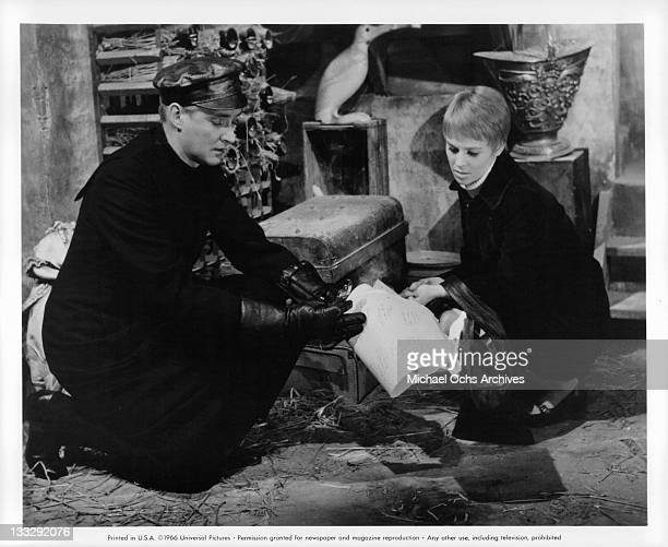Julie Christie and Oskar Werner search papers in a scene from the film Fahrenheit 451' 1966