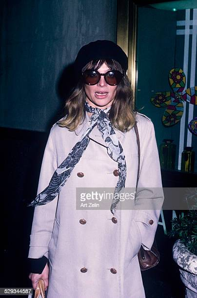 Julie Christie in a gray trench coat and sunglasses; circa 1970; New York.
