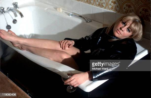 Julie Christie lying in a bath 1964