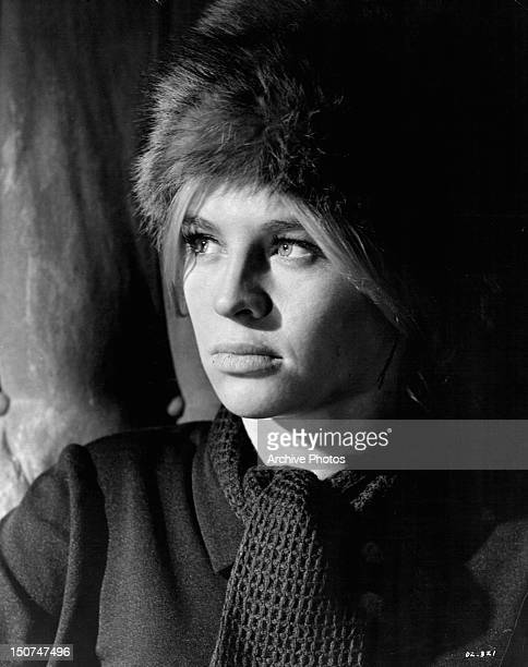 Julie Christie wearing a fur hat and scarf in a scene from the film 'Doctor Zhivago' 1965