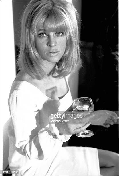 Julie Christie with a glass of wine 1964