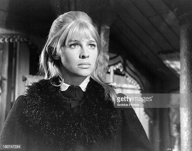 Julie Christie with a serious look on her face in a scene from the film 'Doctor Zhivago' 1965