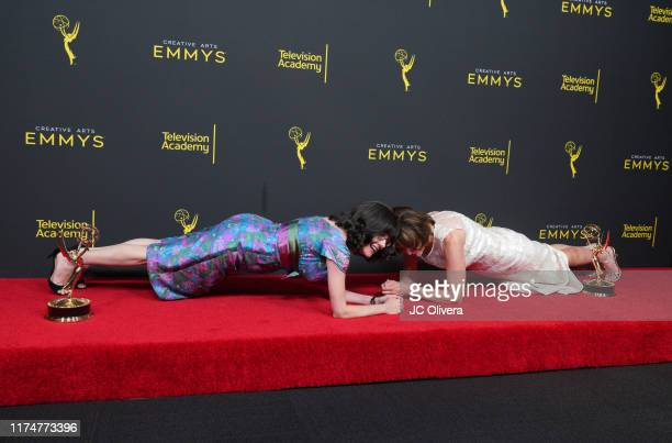 "Julie Cohen and Betsy West pose in plank position in the press room with their awards for exceptional merit in documentary filmmaking for ""RBG"" in..."