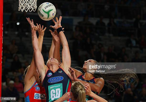 Julie Corletto and Geva Mentor of the Vixens compete for the ball with Amorette Wild and Susan Pratley of the Swifts during the round nine ANZ...
