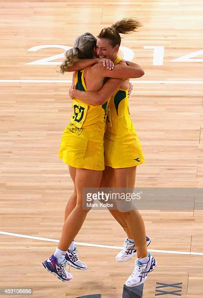 Julie Corletto of Australia celebrates victory with Laura Geitz of Australia during the Netball Gold Medal match between New Zealand and Australia at...