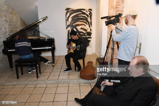 Julie Cormier at piano and Jonathan Velasquez at guitar Larry Clark as spectator during the Concert at Galerie Rue Hus as part of Larry Clark Photos...