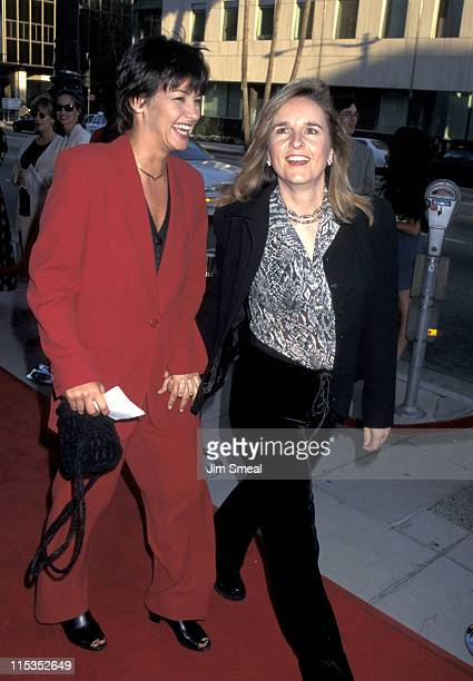 Julie Cypher and Melissa Etheridge during Premiere of The Net at Academy Theater in Beverly Hills California United States