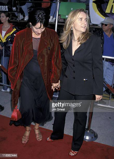 Julie Cypher and Melissa Etheridge during The XFiles Los Angeles Premiere at Mann Village Theatre in Westwood California United States