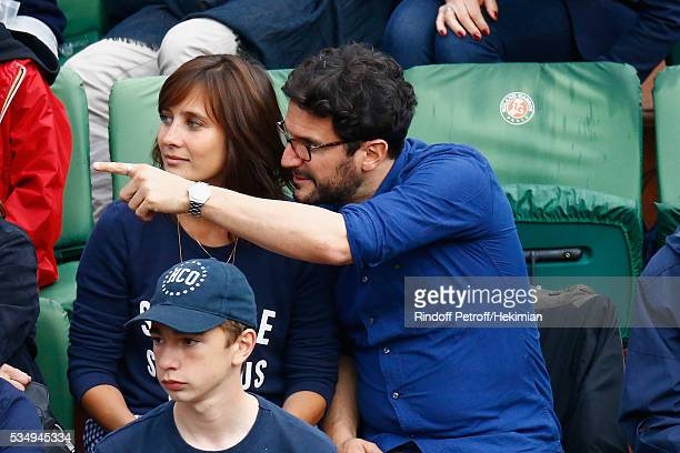Julie de Bona and her boyfriend attend the Jo Wilfied Tsonga match during the French Tennis Open at Roland Garros on May 28 2016 in Paris France
