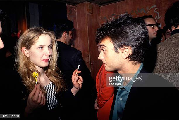 Julie Delpy and Thomas Langmann attend a fashion week Party at Les Bains Douches in the 1990s in Paris France