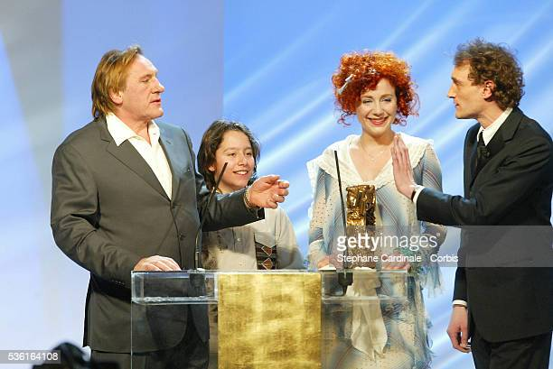 Julie Depardieu receives a surprise visit on stage by father Gerard Depardieu and Antoine Pialat as she receives one of two awards for Best...