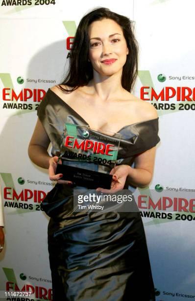 Julie Dreyfus hold the Best Actress Award on behalf of Uma Thurman