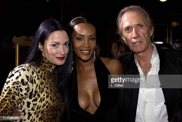 Julie Dreyfus Vivica A Fox and David Carradine during 'Kill Bill Vol 1' Premiere Red Carpet at Grauman's Chinese Theater in Hollywood California...