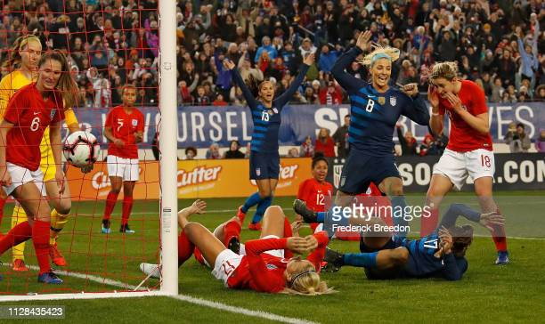 Julie Ertz and Alex Morgan celebrate as Tobin Heath scores a goal against England during the second half of the 2019 SheBelieves Cup match between...