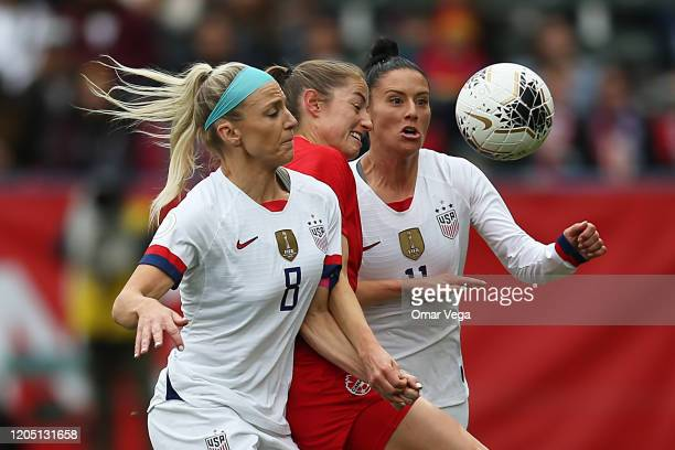 Julie Ertz and Ali Krieger of USA compete for the ball with Janine Beckie of Canada during the Final game between Canada and United States as part of...