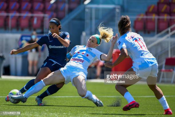 Julie Ertz of Chicago Red Stars fights for the ball with Lynn Williams of North Carolina Courage during a game on day 5 of the NWSL Challenge Cup at...