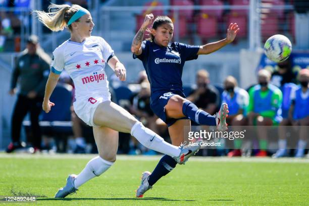 Julie Ertz of Chicago Red Stars races Debinha of North Carolina Courage to the ball during a game on day 5 of the NWSL Challenge Cup at Zions Bank...