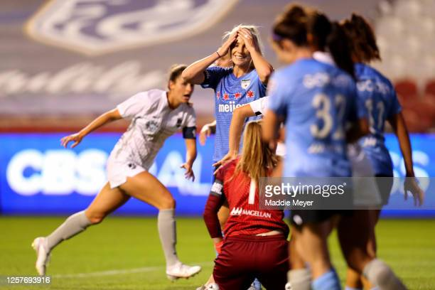 Julie Ertz of Chicago Red Stars reacts after scoring an own goal on Alyssa Naeher in the 77th minute during the second half in the semifinal match...