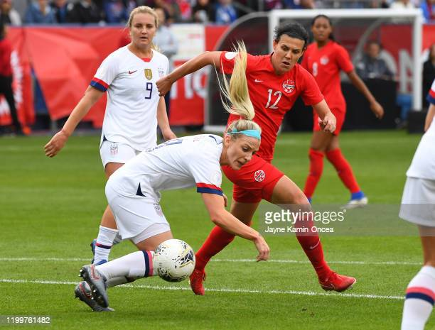 Julie Ertz of the United States and Christine Sinclair of Canada battle for the ball in the first half of the CONCACAF Women's Olympic Qualifying...