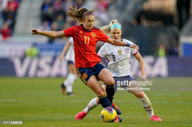 Julie Ertz of the United States defends against Alexia Putellas of Spain during a game between Spain and USWNT at Red Bull Arena on March 08, 2020 in...