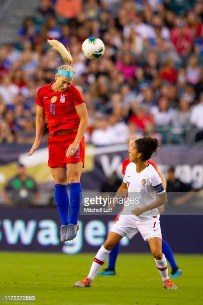 Julie Ertz of the United States goes up for a header against Claudia Neto of Portugal in the second game of the USWNT Victory Tour at Lincoln...