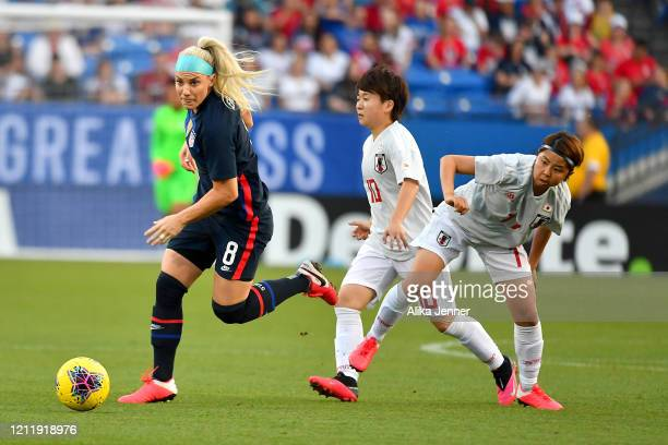 Julie Ertz of the United States moves the ball against Emi Nakajima of Japan and Yuka Momoki during the first half of the SheBelieves Cup match at...