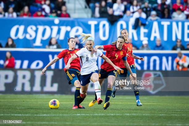 Julie Ertz of the United States tries to get past Irene Paredes of Spain and Patricia Guijarro of Spain during the 1st half of the 2020 SheBelieves...