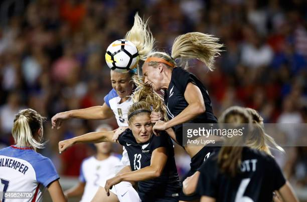 Julie Ertz of the USA and Rosie White and Kirsty Yallop of New Zealand battle for the ball during the match at Nippert Stadium on September 19 2017...