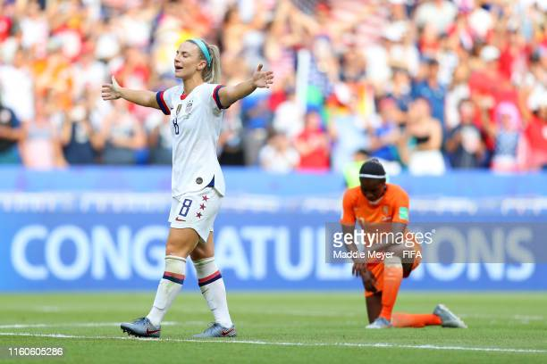 Julie Ertz of the USA celebrates as Lineth Beerensteyn of the Netherlands looks dejected following the 2019 FIFA Women's World Cup France Final match...