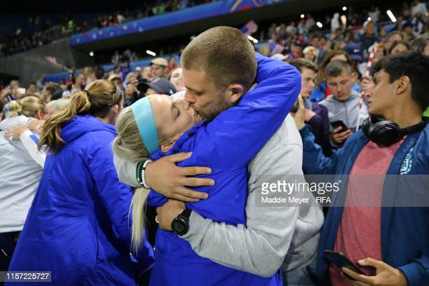 Julie Ertz of the USA celebrates with husband Zach Ertz following her team's victory in the 2019 FIFA Women's World Cup France group F match between...