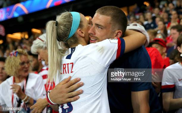 Julie Ertz of the USA celebrates with husband Zach Ertz following her team's victory in the 2019 FIFA Women's World Cup France Quarter Final match...
