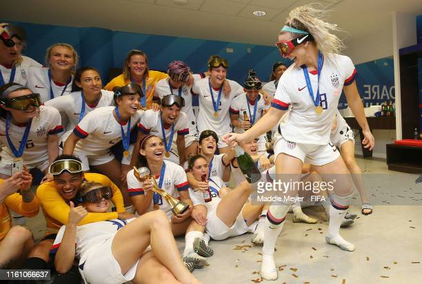 Julie Ertz of the USA dances in front of her teammates in the locker room after the 2019 FIFA Women's World Cup France Final match between The United...