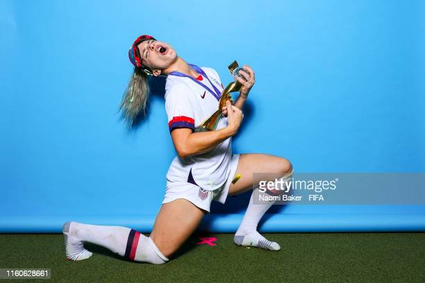 Julie Ertz of the USA poses with the Women's World Cup trophy after the 2019 FIFA Women's World Cup France Final match between The United State of...