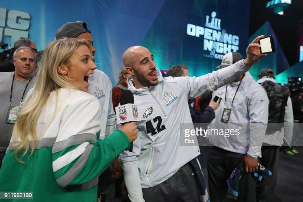 Julie Ertz of the USA women's national soccer team and wife of Zach Ertz of the Philadelphia Eagles poses for a selfie with Jordan Hicks and Chris...