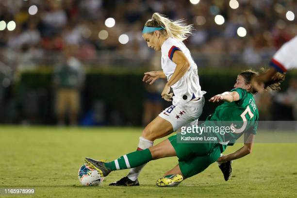 Julie Ertz of United States and Niamh Fahey of Republic of Ireland fight for control of the ball during the second half of the first game of the...