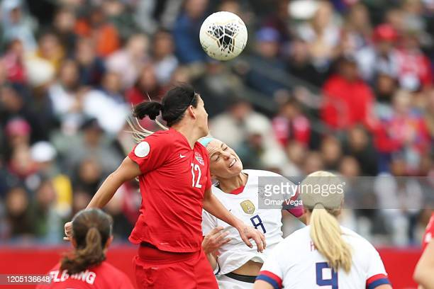 Julie Ertz of USA and Captain of Canada Christine Sinclair head the ball during the Final game between Canada and United States as part of the 2020...