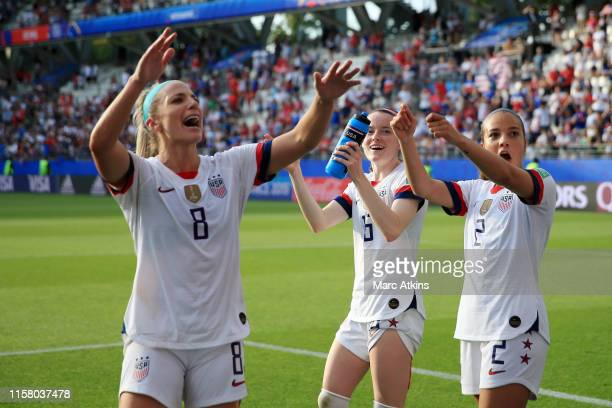 Julie Ertz, Rose Lavelle and Mallory Pugh of the USA celebrate victory after the 2019 FIFA Women's World Cup France Round Of 16 match between Spain...