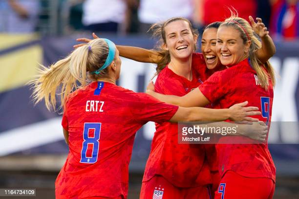 Julie Ertz, Tierna Davidson, Christen Press, and Lindsey Horan of the United States celebrate a goal by Tobin Heath against Portugal in the first...