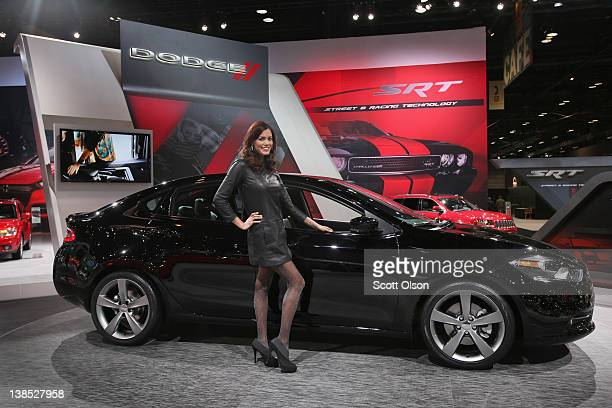 Julie Etheridge helps Dodge show off the new Dart during the media preview of the Chicago Auto Show at McCormick Place on February 8 2012 in Chicago...