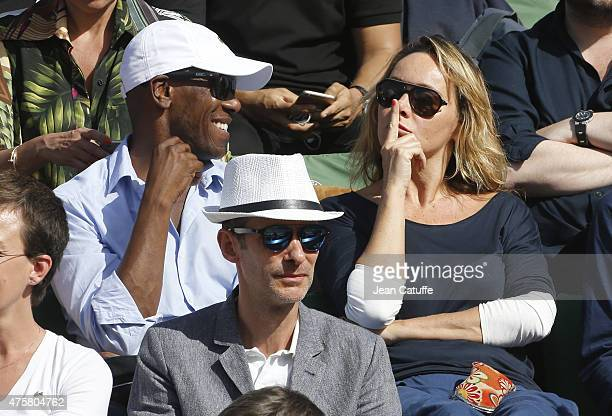 Julie Ferrier and her boyfriend attend day 11 of the French Open 2015 at Roland Garros stadium on June 3 2015 in Paris France