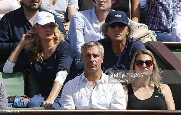 Julie Ferrier Elie Chouraqui below Yann Delaigue and Astrid Bard attend day 11 of the French Open 2015 at Roland Garros stadium on June 3 2015 in...