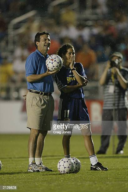 Julie Foudy of the San Diego Spirit representing the American Stars looks on with husband/coach Ian Sawyers of the San Jose Cyberrays during the WUSA...