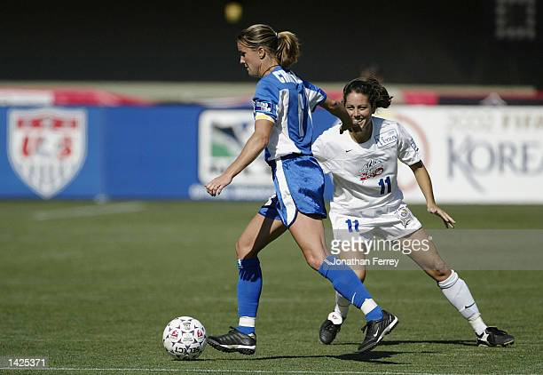 Julie Foudy of the South defends Brandi Chastain of the North on September 21 2002 during the WSUA Allstar Game at PGE Park in Portland Oregon
