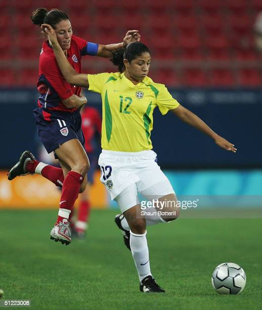 Julie Foudy of the United States attempts to tackle Cristiane of Brazil during the women's football gold medal match on August 26 2004 during the...