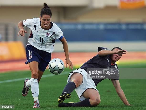 Julie Foudy of USA and Pia Wunderlich of Germany compete for the ball during the women's football semifinal match between USA and Germany on August...