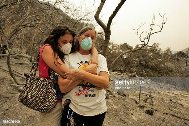 Julie Garcia and her daughter Jessi Garcia hug each other after seeing their home gutted by Station Fire that swept through their neighborhood on La...