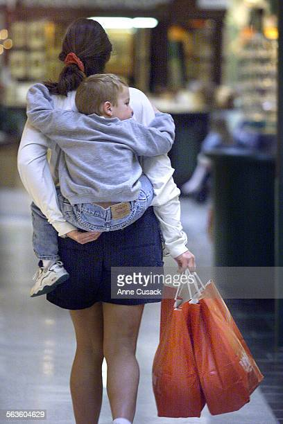 Julie Gerety carriers her four year old son Connor on her back while shopping at the Oaks Mall She is from Thousand Oaks