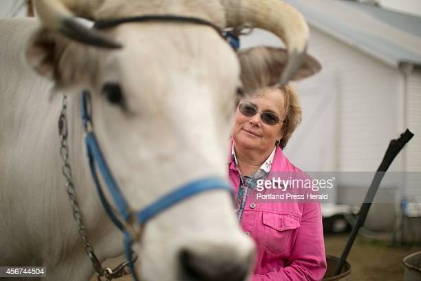 Julie Giles of Lady Luck Farm in Steep Falls has been coming to the Fryeburg Fair for 39 years. This year, she entered her oxen in a pulling...