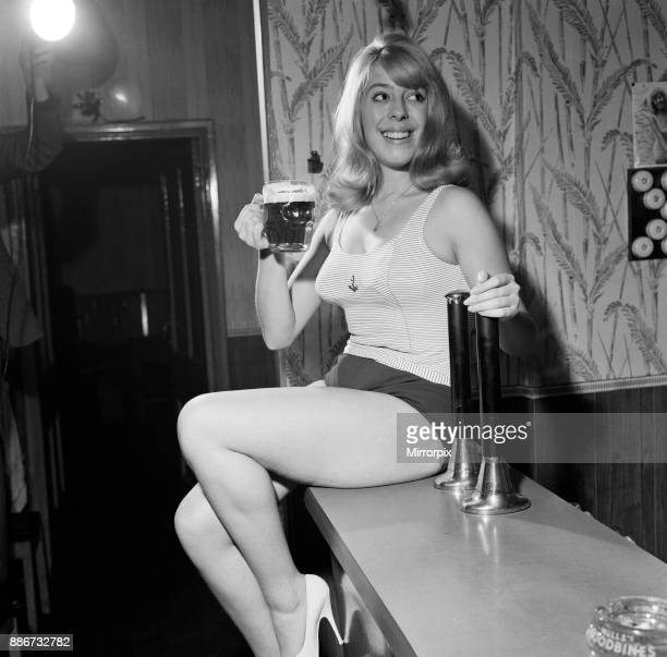 Julie Goodyear aged 21 a Solicitors Secretary is the daughter of the licensee of the Bay Horse Hotel in Hopwood Lancashire She helps out in the bar...